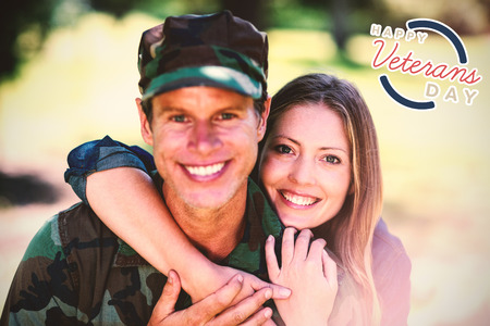 solider: Logo for veterans day in america  against smiling couple