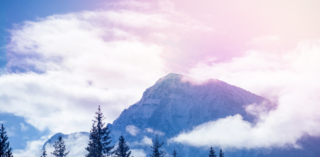 Scenic view of mountain against cloudy sky Stock Photo