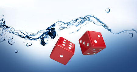 Graphic image of 3D red dice against water bubbling on white surface Stock Photo