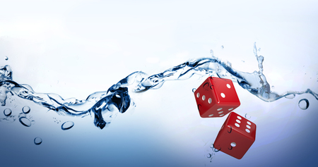 Digital composite image of red dice against water bubbling on white surface