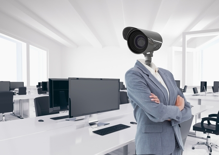 Digital composite of Businesswoman with CCTV head at office Stock Photo