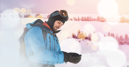 preparations: Digital composite of man standing on ski slope