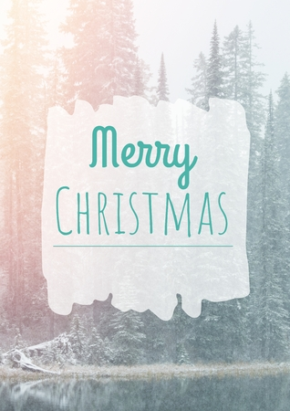 Digital composite of merry Christmas text on snow background