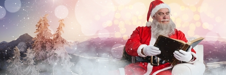 Digital composite of Santa with Winter landscape reading book