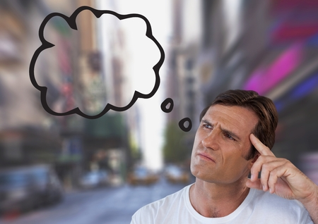 Digital composite of man looking up at thought cloud Stock Photo