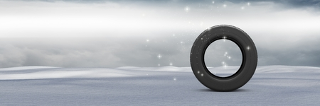 Digital composite of Tyre in Winter snow landscape Stock Photo