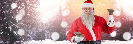 Digital composite of Santa with Winter landscape with bell
