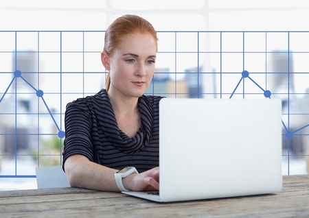 Digital composite of Businesswoman at desk with laptop and grid chart points