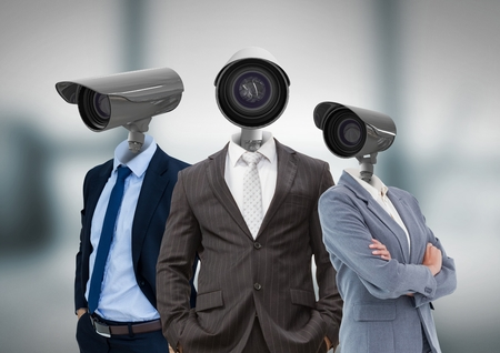 Digital composite of Businessman with CCTV head at office 스톡 콘텐츠
