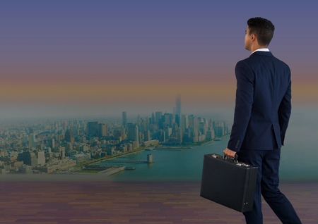 Digital composite of Businessman holding briefcase over city