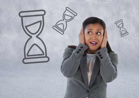 Digital composite of frustrated woman with hourglasses Stock Photo