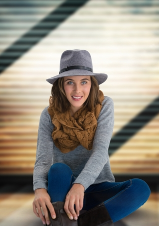 ridged: Digital composite of Woman in hat and scarf with soft ridged background Stock Photo