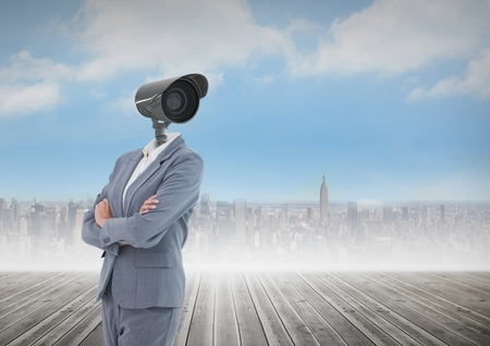 Digital composite of Businesswoman with CCTV head  with city skyline
