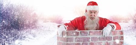 Digital composite of Santa with Winter landscape in chimney