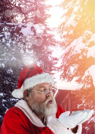 Digital composite of Santa with Winter landscape