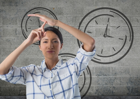 Digital composite of frustrated woman with clocks