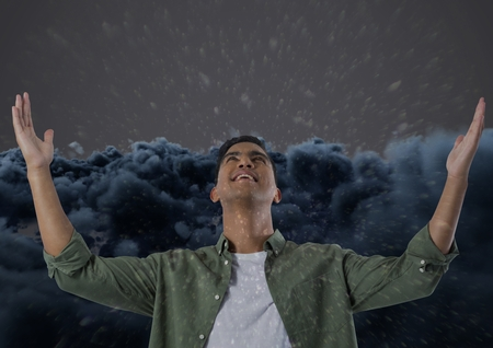 Digital composite of Frustrated man in front clouds Stock Photo