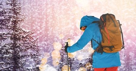 Digital composite of man skiing on slope