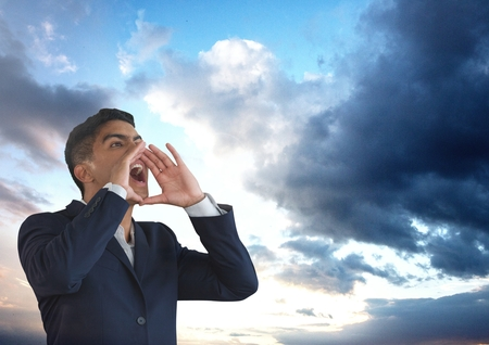 Digital composite of Businessman shouting under clouds Stock Photo