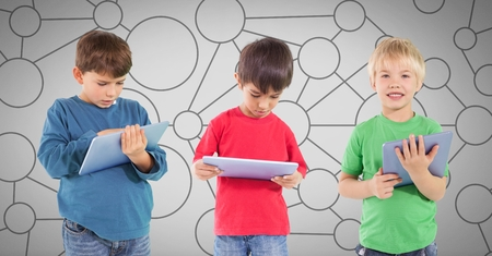 Digital composite of Three Boys against grey background with tablet devices and connecting mind map circles Reklamní fotografie - 88480227