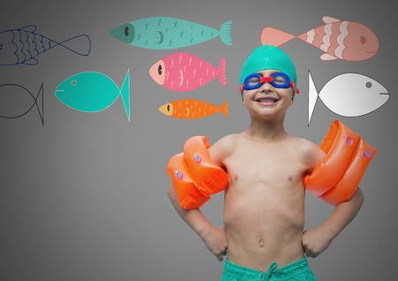 swimming cap: Digital composite of Boy against grey background with swimming gear and colorful fish illustrations Stock Photo