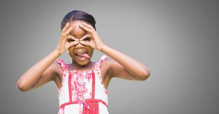 Digital composite of Girl against grey background with hands gesture of binoculars