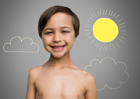 Digital composite of Boy against grey background smiling and sun and clouds