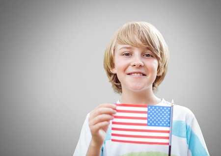 Digital composite of Boy against grey background with american flag