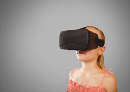 Digital composite of Girl against grey background with virtual reality headset