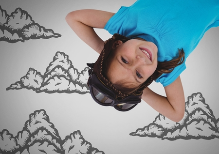 Digital composite of Girl against grey background with goggles upside down and cloud illustrations Stock Photo