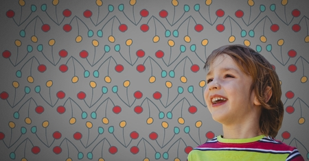 Digital composite of Boy against grey background happy and colorful pattern