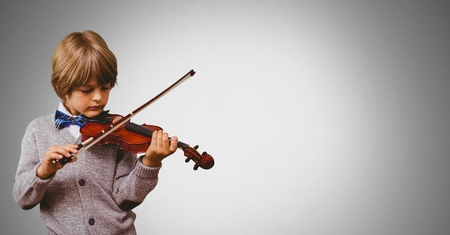 Digital composite of Boy against grey background playing violin Stock Photo
