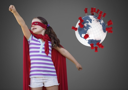 Digital composite of Girl against grey background with superhero costume and world globe with location pins Stock Photo