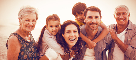 Portrait of smiling happy family posing at beach Stock Photo