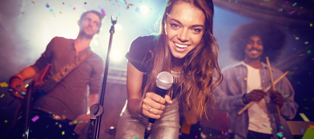 Flying colours against portrait of singer with musicians on stage at nightclub