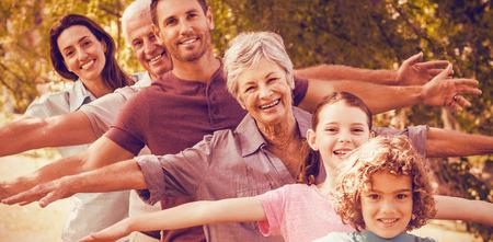 Portrait of extended family smiling in park