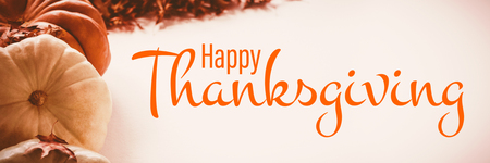 Illustration of happy thanksgiving day text greeting against pumpkins arranged by autumn leaves