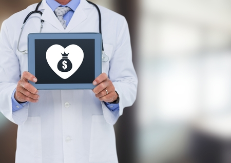 Digital composite of Doctor holding tablet with heart and money bag icon