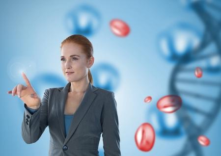 Compuesto digital de empresaria tocando aire frente a micro organismos de ciencia Foto de archivo