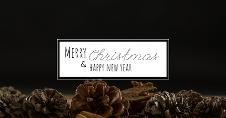 Digital composite of merry Christmas and happy new year text on christmas background Stock Photo