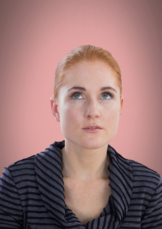 thoughtful: Digital composite of Woman looking up with pink background Stock Photo