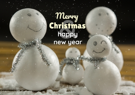 Digital composite of merry Christmas and happy new year text on Christmas background with snow