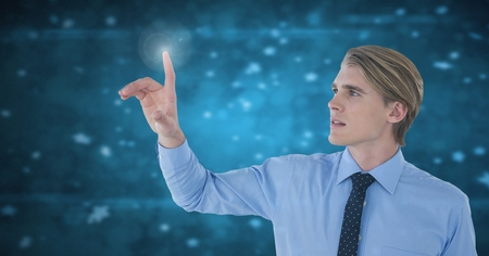 Digital composite of Businessman touching air in front of blue light particles
