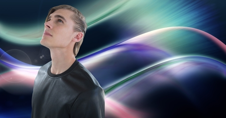 Digital composite of Man looking up with colorful curves background