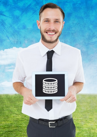 Digital composite of Man holding tablet with money icon