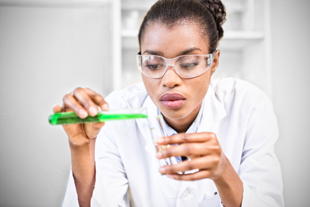 Scientist with glasses making mixed chemical Stock Photo