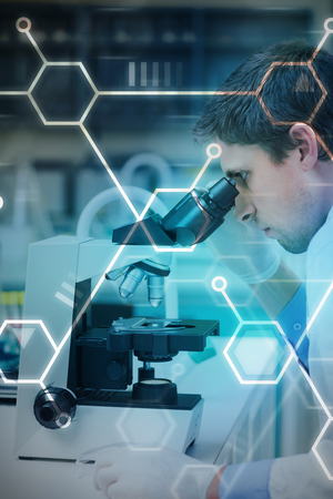Digital data  against scientific researcher using microscope in the laboratory
