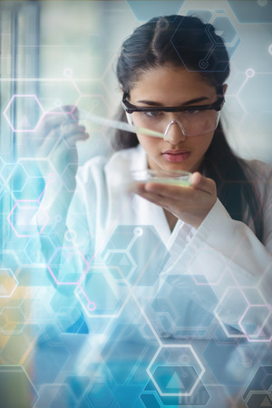 Graph digital  against attentive schoolgirl experimenting in laboratory