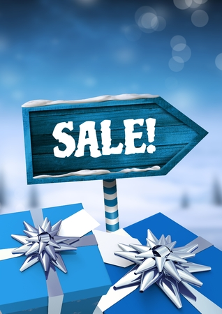 Digital composite of Sale text and gifts with Wooden signpost in Christmas Winter landscape Stock Photo