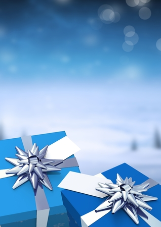 Digital composite of Gifts in Christmas Winter landscape Stock Photo
